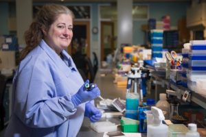 Dr. Marianne Barrier working at her lab bench