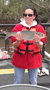 Dr. Heather Evans Holding a Fish