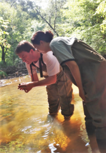 Dr. Heather Evans Working in a River