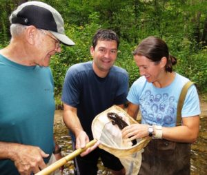 Bryan Stuart, Harold Voris and Jennifer Sheridan with a Hellbender (Cryptobranchus alleganiensis) in western North Carolina.