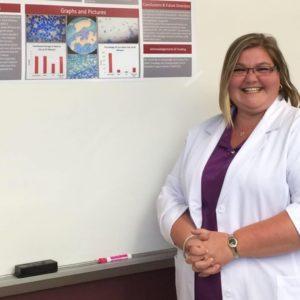Dawn Stancil giving a poster presentation
